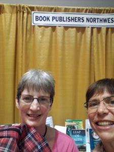 PNBA raffle prize winner with booth volunteer Posy Gering.